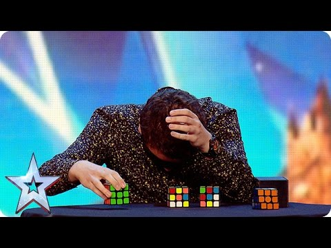 Watch Flavian solve three Rubik's Cubes…BLINDFOLDED!  | Brit