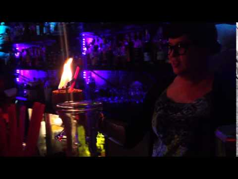 Sierra lighting a Tiki Cocktail on fire at Hale Pele Portland OR