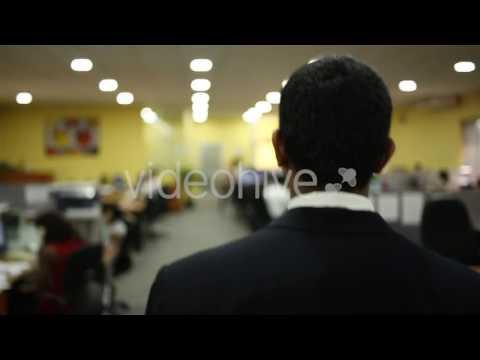 Asian Man Walking Through Office (Stock Footage)