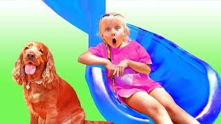Little girl plays wtih magical Giant slide