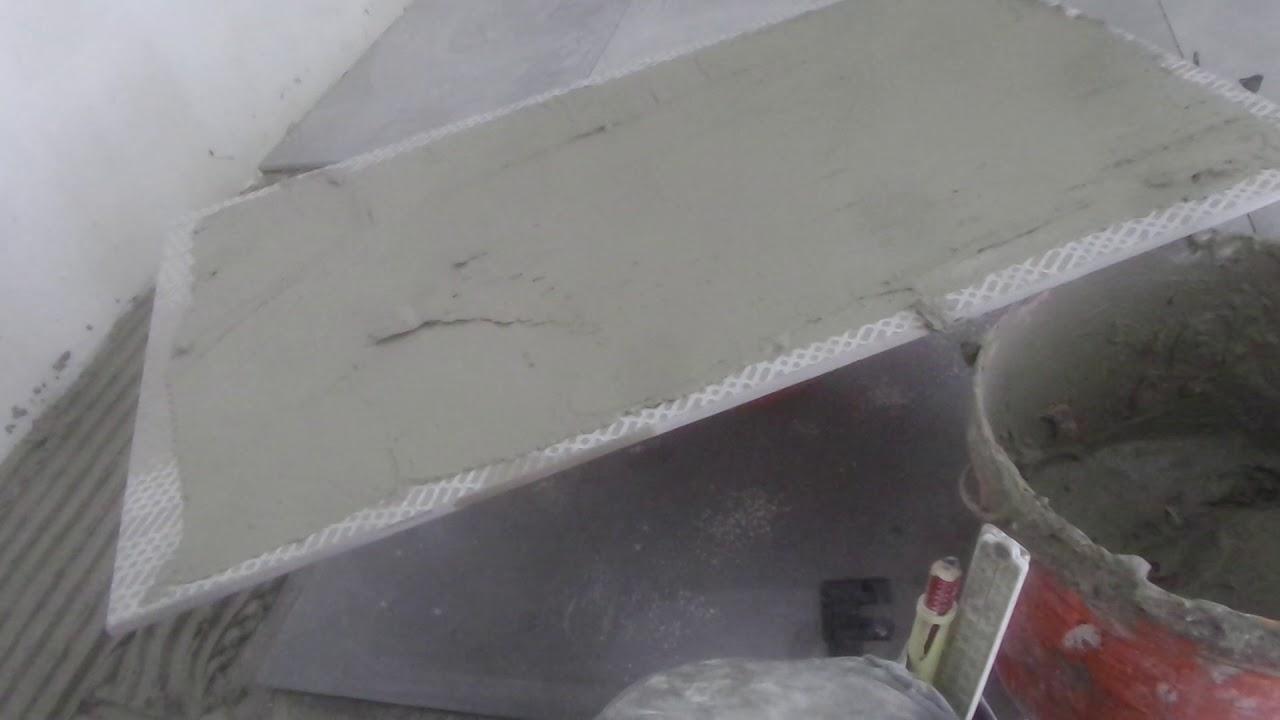 Grote tegels leggen in badkamer - YouTube