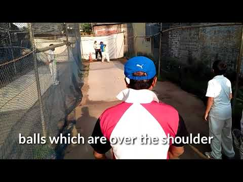 batting practice through knocking with narrow bat and tennis balls