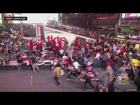 Deanna King - Video: Motorcycle Backfire Stirs Panic in NYC's Times Square
