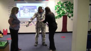 How to put on a spacesuit