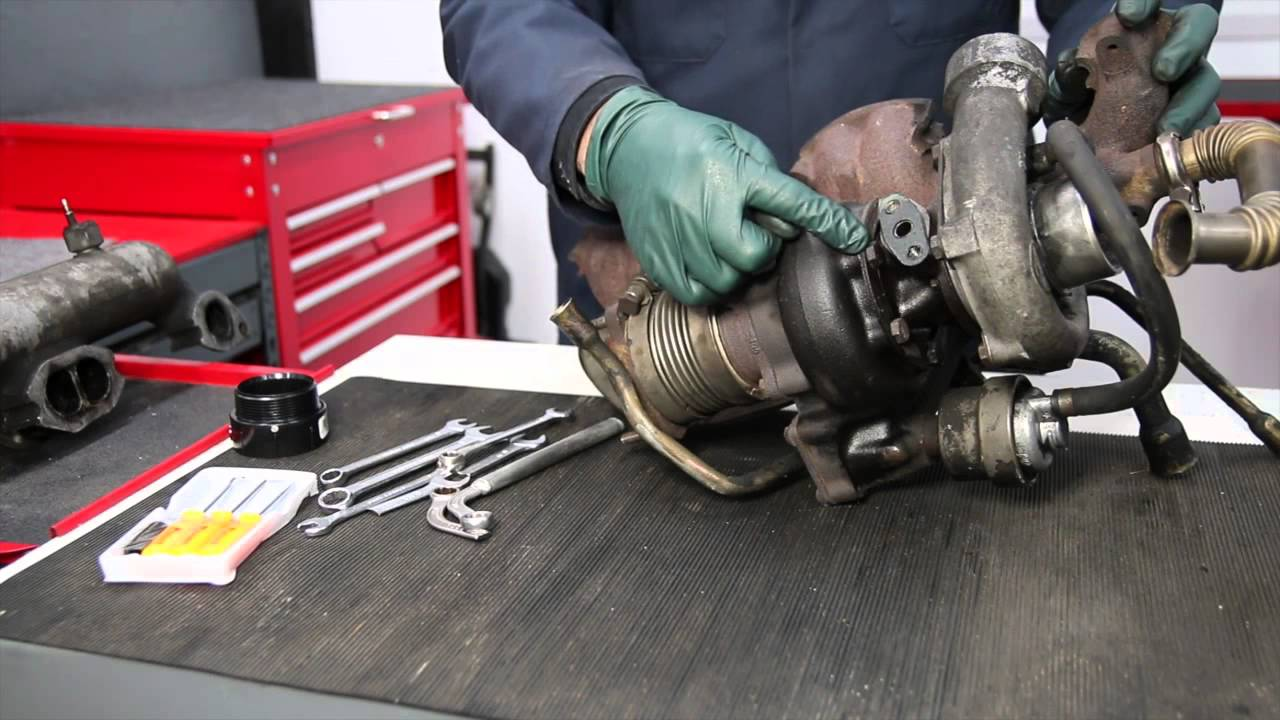 removing a turbocharger from a mercedes om617 turbo diesel engine