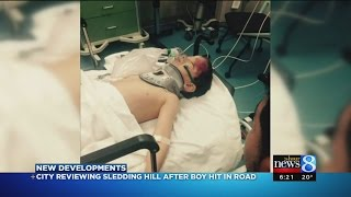 Boy hit by car while sledding; 2 wanted for questioning