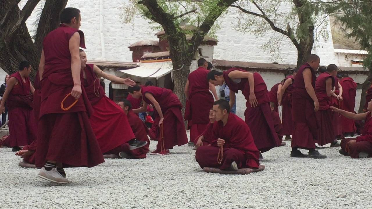 Image result for buddhist monks practising debate