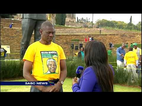 Circle of unity formed around Madiba's statue in Pretoria