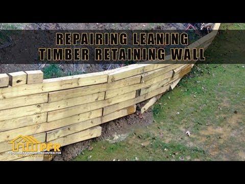 REPAIRING LEANING TIMBER RETAINING WALL   CHARLOTTE NC
