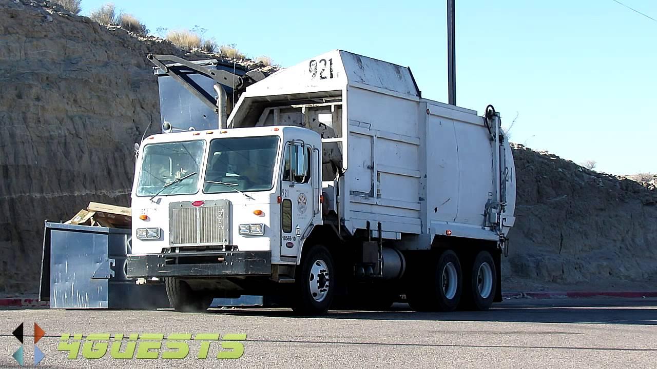Peterbilt Garbage Truck Side Loader In Action At Dumpsters
