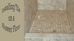 How to install a mosaic tile on a shower floor.