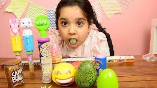 اكلنا حلويات غريبة عيون حامضة !! بيضة ديناصور و بيضة ايموجي !! حلاوة فيها 36 نكهة !!