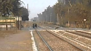 Pakistan Railways Pak Business Express rushing past Green Town, Lahore Suburbs