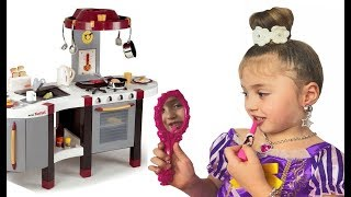 Little Girl Play with Makeup Table Toy