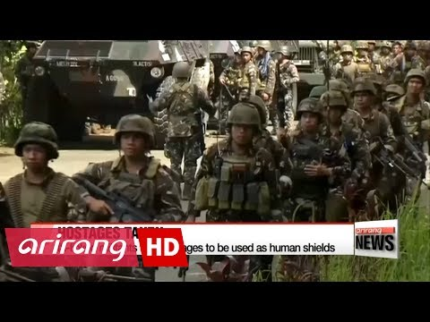 Philippine troops battle Islamists in besieged city of Marawi