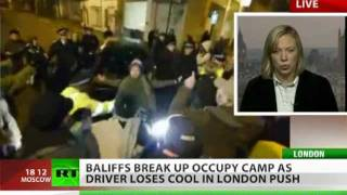 Occupy London assault: Bailiff plows car through protesters
