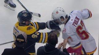 Marchand given unsportsmanlike penalty for grabbing Frolik's face mask
