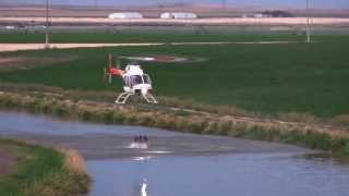 Download Bell 407 Helicopter grabbing water from canal with Bambi Bucket