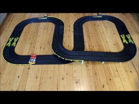 4 lane slot cars race with Tyco cars: Volvo 850, Porsche Turbo, Lamborghini and Chevy Hardtop