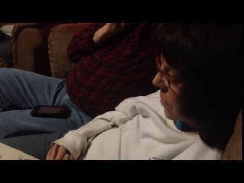 Joshua kisses Mom's hand