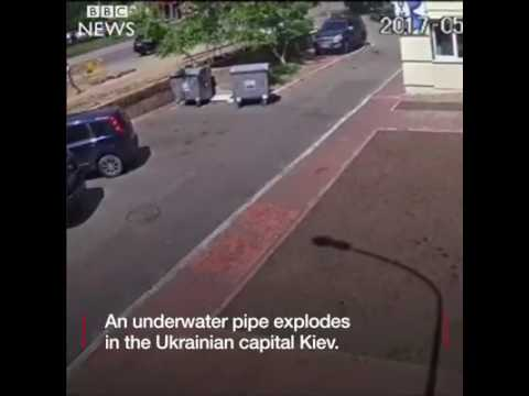 The dramatic moment an underground water pipe in Kiev blows up.