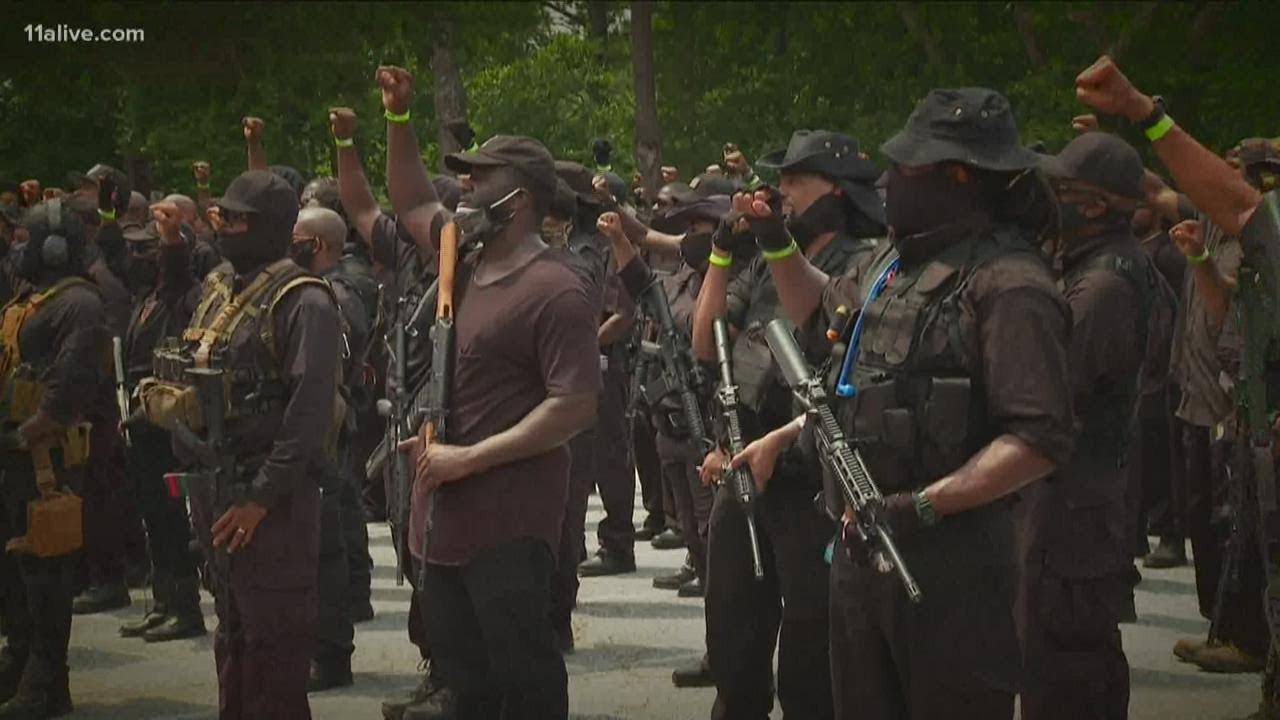Group of demonstrators enter Stone Mountain Park