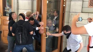 Protesters storm Portland City Hall, guards injured (GRAPHIC LANGUAGE)
