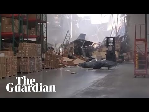 Damage filmed inside warehouse after fighter jet crash in California- video