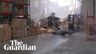 Damage filmed inside warehouse after fighter jet crash in California- video