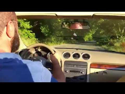 DRIVING A CONVERTIBLE CAR ALONG THE NATURE OF EVIA (GREECE)