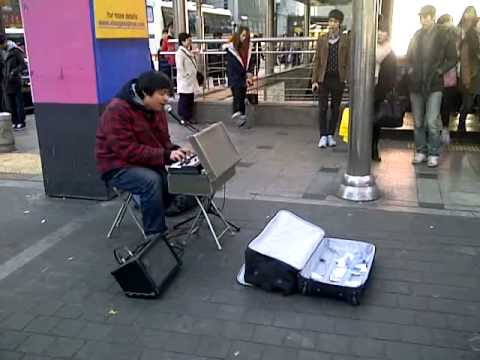 Korean Guy - Playing Yesterday By The Beatles (@Myeongdong Market).3GP