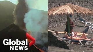 La Palma volcano: Beachgoers not fazed by eruption as Spain declares island a disaster zone