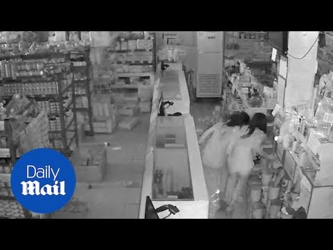 People Run For Cover Inside Shop As Earthquake Strikes Philippines