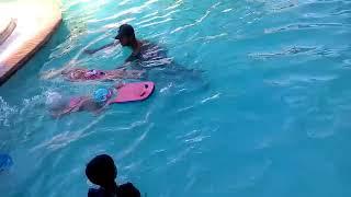 little girl doing floating in swimming
