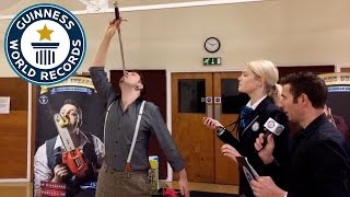 Most swords swallowed in 3 minutes - Guinness World Records