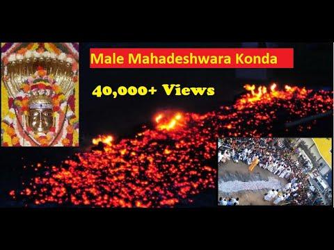 Walking barefoot on fire, holding god Shiva's idol in male mahadeshwara temple ..love the music