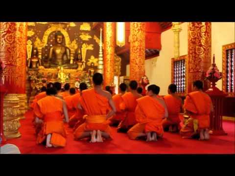 Chanting monks at Wat Phra Kaew, Chiang Rai Thailand