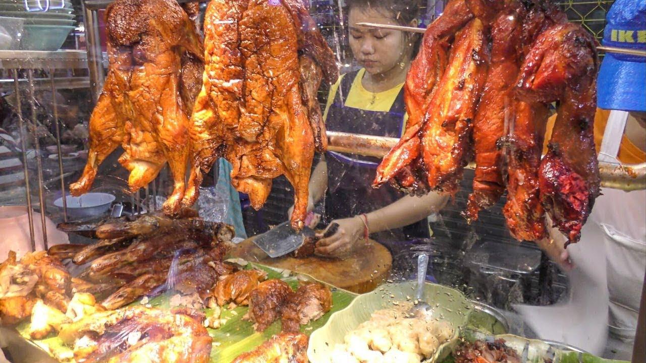 Chinese Street Food in Bangkok, Thailand. Jumbo Lobster, Crispy Pork, Duck, Prawn. Yaowarat Road