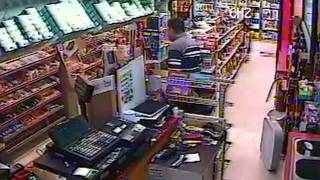 Detectives Searching For Armed Robber