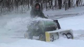 "John Deere 125 with a 44"" snowblower attachment"