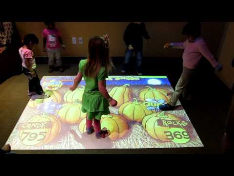 Maddie and an interactive floor at Liberty Science Center
