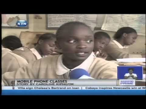 Digital education in slums as pupils revise using mobile phones