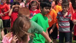 1st grade kids taking plant on Arbor Day celebration