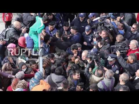 Greece: Scuffles as refugees block migration minister's entrance to Athens camp