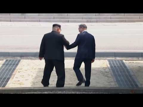 Kim Jong Un Crosses to South, Greets Moon
