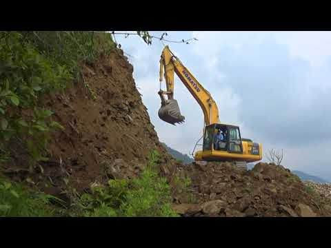Komatsu Excavator Cut Mountain Edge On Himalaya.