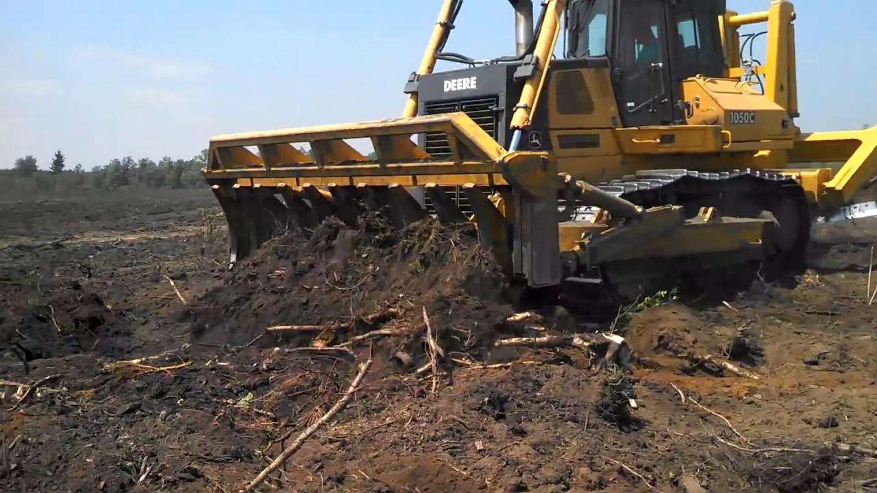 rockland root plow and root rake on a 1050c john deere dozer clearing brush grubbing  [ 1280 x 720 Pixel ]