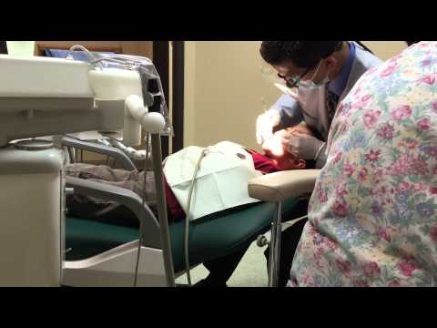 Boy getting teeth checked out by Dentist