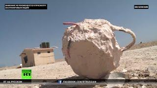 Следы боев за Пальмиру  съемочная группа RT нашла мины ловушки и тела погибших солдат
