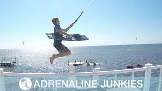 Kitesurfer Jumps From Balcony